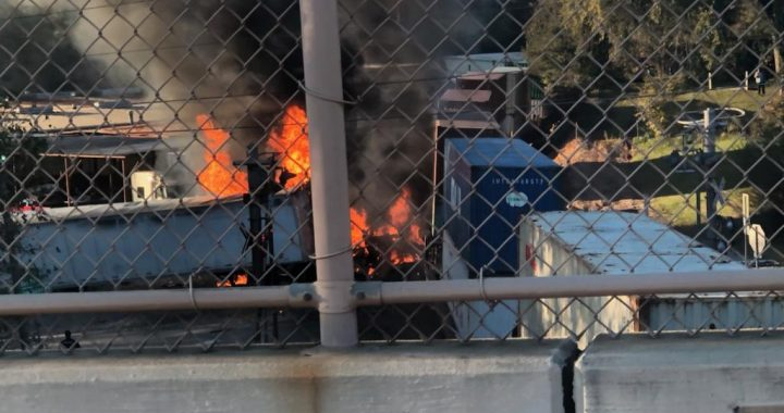 18-wheeler struck by train, bursts into flames