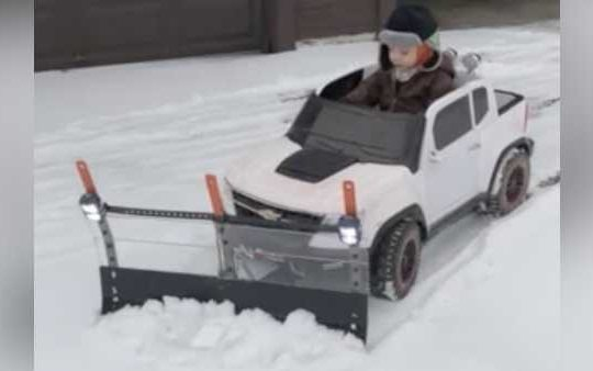 At just 2 years old, an Ohio boy is hard at work plowing snow from his driveway